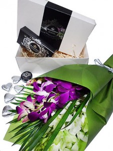 . Gift wrapped orchids, with soap, lip balm and heart chocs in a beautiful box