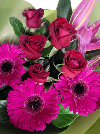 Flower bouquet of stunning pink gerberas, lilies and roses.