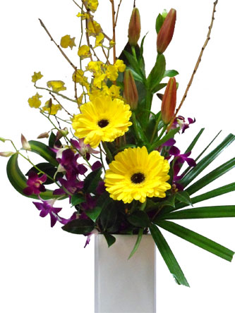 Bright gerberas, orchids, lillies in a ceramic vase